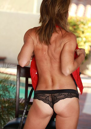Mature lady strips off jeans to show off great legs in panties