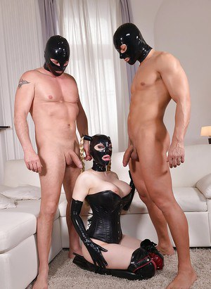 European fetish model Latex Lucy blowing cock in pigtails during MMF 3some