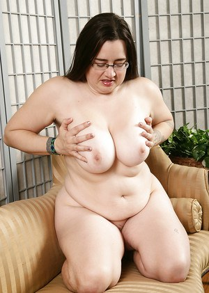 Older brunette fatty in glasses baring big boobs and hairy vagina