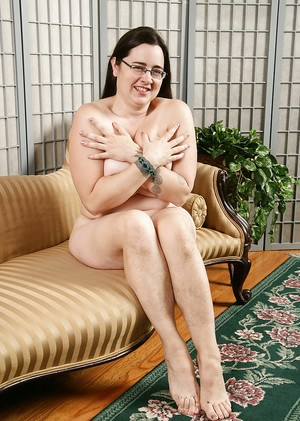 Mature plumper in glasses with hairy legs unveiling big mature boobs