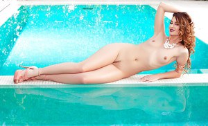 Centerfold babe Melissa Jean freeing tiny tits and ass from retro swimsuit