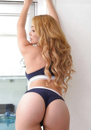 Busty blonde babe Skyla Novea showing off round ass in thong underwear