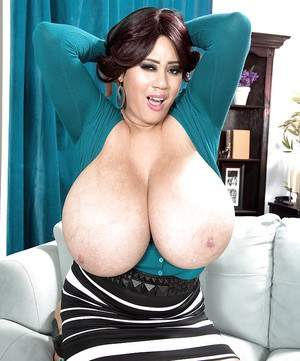 Chubby brunette MILF Roxi Red baring monster tits after upskirt panty flash