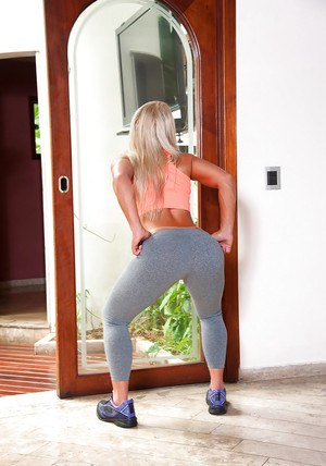 Latina babe Lorena Fire frees big booty from yoga pants before masturbating