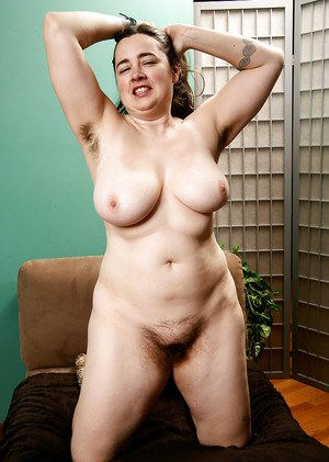 Mature fatty with hairy legs freeing big tits and beaver from underthings