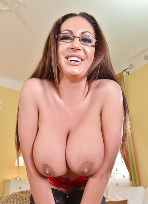 Glasses wearing babe Emma Butt unveiling massive MILF hooters