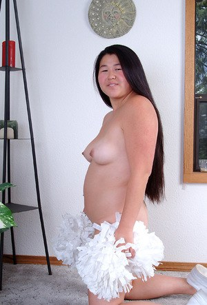 Overweight Asian amateur sliding underwear over to expose hairy vagina
