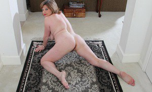Chubby mature lady Kathy Gilbert loosing large natural juggs from blouse