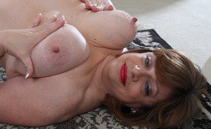 Mature plumper Kathy Gilbert unveiling massive hanging boobs