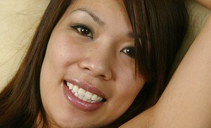 Asian amateur strips out of panties and lingerie to expose small breasts