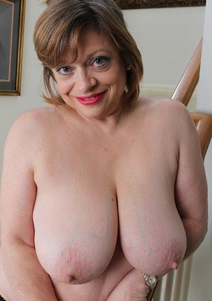 Older fatty Kathy Gilbert loosing large mature tits from lingerie