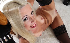 Stocking garbed mature blonde revealing tiny tits and shaved pussy