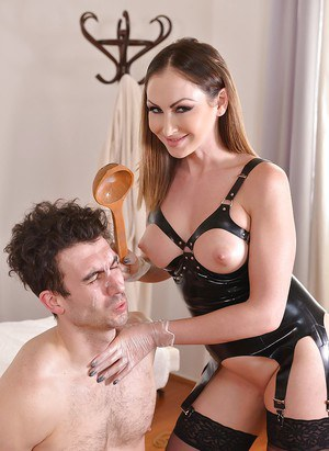 Stocking attired female dominant Yasmin Scott dishing out CBT in high heels