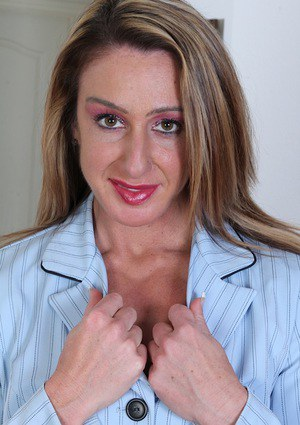 Mature lady Ashley Brooke spreading shaved pussy after lingerie removal