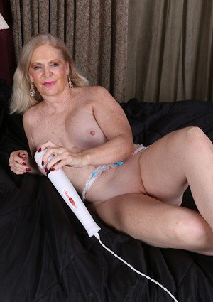 Mature plumper Judy Belkins toying shaved pussy with large sex toy