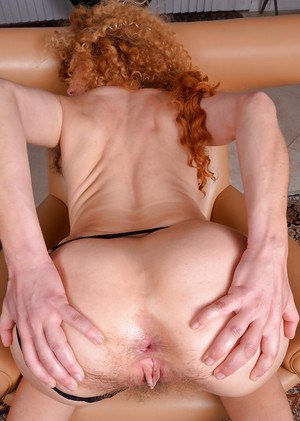 Mature redhead Leona slipping thong panties off of nice ass