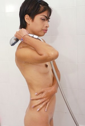 Ugly Asian first timer revealing tiny breasts and hairy snatch in shower