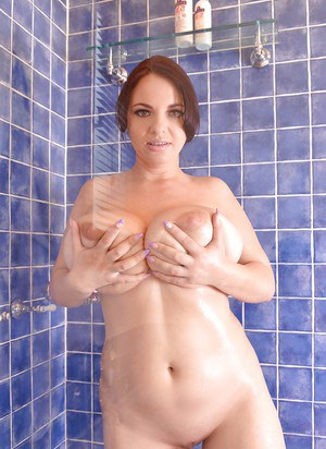 Chubby MILF Joanna Bliss freeing huge hangers and shaved pussy in shower