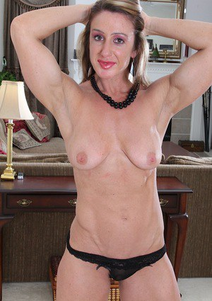 Busty mature dame Ashley Brooke spreading labia lips after undressing