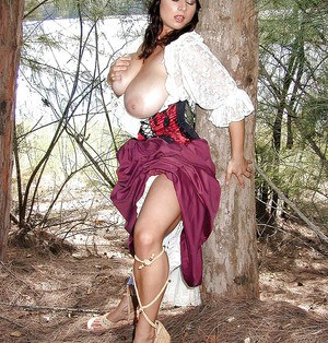 Solo girl Chloe Vevrier freeing huge French MILF juggs in the forest