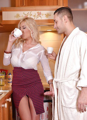 Busty blonde Dona Bell giving big cock blowjob and handjob in kitchen