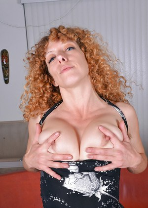 Aged redhead Leona displaying furry underarms before revealing clitoris