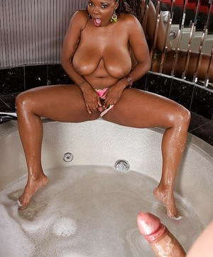 Busty ebony Stacy Adams providing big cock with titty fuck in hot tub