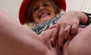 Thick granny Judy Belkins revealing big tits and ass while undressing