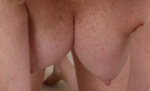 Chunky granny Judy Belkins revealing shaved pussy and large boobs