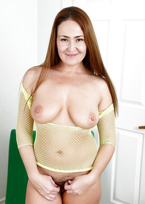 Busty solo girl Elexis Monroe spreading hairy pussy for sex toy insertion