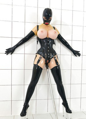 Fetish clad Latex Lucy flaunting big MILF tits while penetrated with dildo