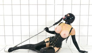 BDSM enthusiast Latex Lucy toying MILF pussy in fetish clothing and hood