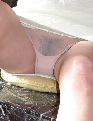 Amateur Asian chick Miki freeing hairy pink pussy from pantyhose