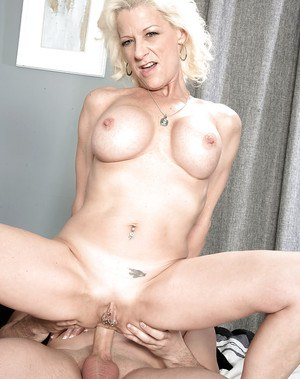 Blonde cougar Madison Paige displaying pierced cunt before taking ass fuck