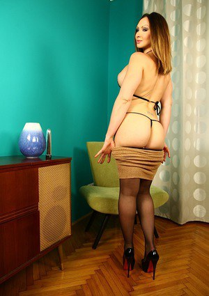 Skirt and nylon attired Yasmin Scott baring big breasts while undressing