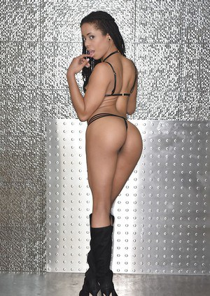 Black pornstar Kira Noir showing off phat ass in knee high boots
