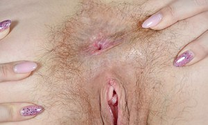 Ugly older broad Corazon Del Angel parting hairy pink pussy up close