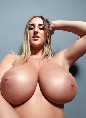 Blonde lingerie model Stacey Poole revealing large all natural breasts