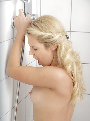 Barely legal blonde Taylor demonstrating small wet tits while showering