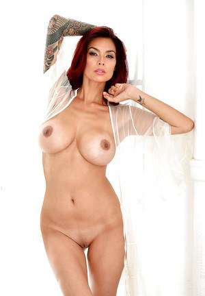 Hot redhead pornstar Tera Patrick touting huge Asian tits in high heels