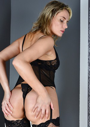Dirty mature blonde Regina spreading ass cheeks wide open in black nylons