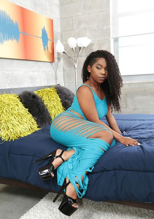 Clothed ebony woman Finesse unveiling big black ass in high heels