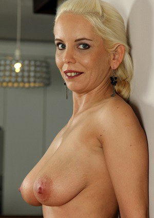 Aged blonde Sandy Figgs unveiling large breasts and shaved vagina