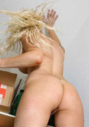 Aged blonde with big boobs Mickalah posing with pussy wide open