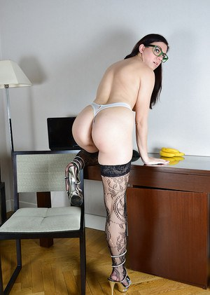 Glasses wearing brunette Corazon Del Angel stripping off sexy stockings