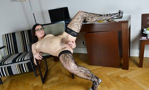 Dark haired MILF Corazon Del Angel stretching beaver after undressing