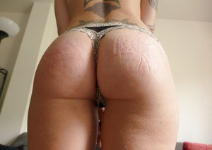 Tattooed first timer Miss Trixx freeing round ass from shorts