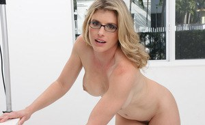 Naked blonde MILF with big tits toying all natural pussy in glasses