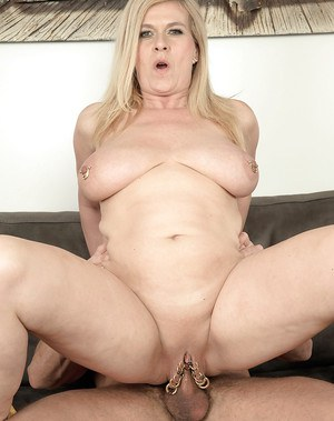 Aged lady Marina Rene revealing pierced nips and vagina during hardcore sex