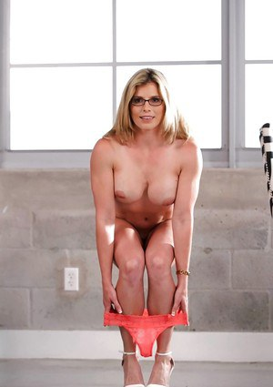 Dirty blonde MILF Cory Chase posing naked after shedding skirt and lingerie